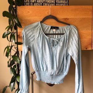 Light blue blouse.